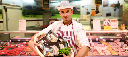 Butcher with superquinn sausages