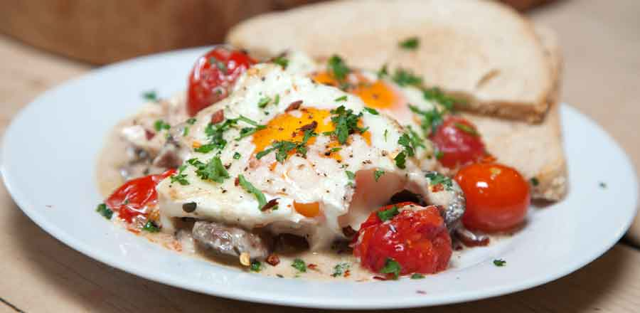 Baked Eggs with Mushrooms, Thyme, Tomatoes and Parmesan - SuperValu
