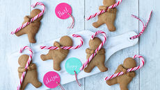 Cuddling candy cane gingerbread men