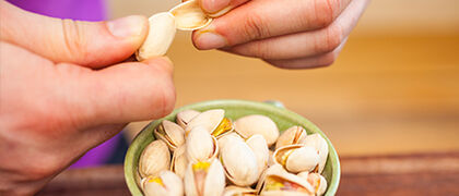 Opening pistachios 450x220px