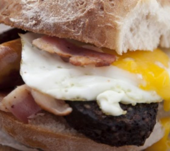 Simple sausage, bacon and egg sandwich