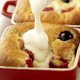 Peach and berry pie with cream