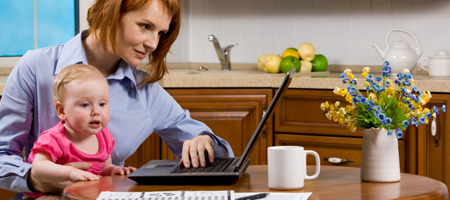 Woman shopping online in the kitchen