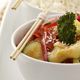 vegetables with rice and chop sticks